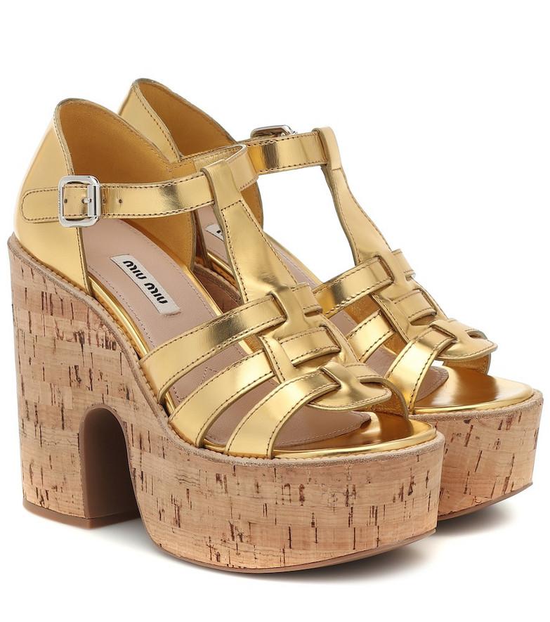 Miu Miu Leather platform sandals in gold