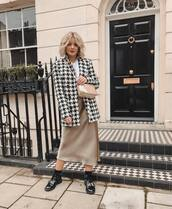 coat,houndstooth,patent shoes,satin,midi skirt,white top,crossbody bag