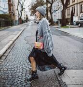 bag,crossbody bag,black boots,lace up boots,black dress,midi dress,asymmetrical,oversized cardigan,grey cardigan,knit,hat