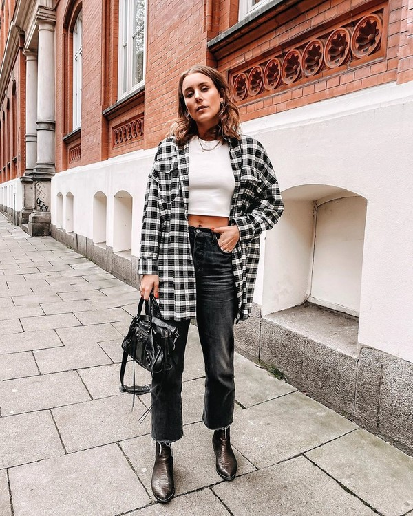 top plaid shirt oversized ankle boots black jeans high waisted jeans black bag white top crop tops