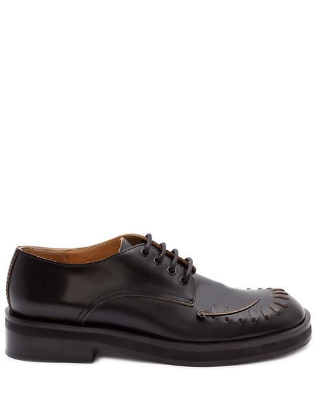 JW Anderson stitch detail derby shoes in black