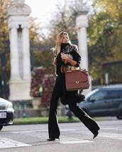 pants,black pants,flare pants,black boots,heel boots,fur vest,turtleneck sweater,black sweater,brown bag
