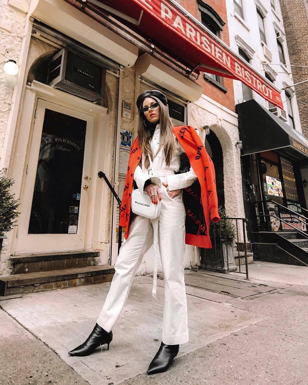 sweater cardigan balenciaga black boots white pants wide-leg pants high waisted pants white bag white jacket beret bag