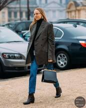 shoes,cowboy boots,denim,jeans,black turtleneck top,double breasted,blazer,patent bag