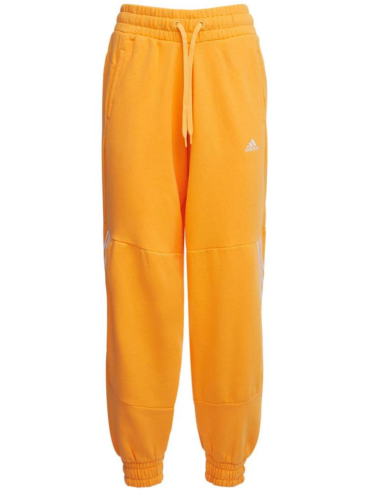 ADIDAS PERFORMANCE Sweatpants in orange