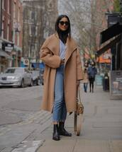 coat,camel coat,long coat,oversized coat,black boots,ankle boots,high waisted jeans,skinny jeans,bag,shirt,black turtleneck top