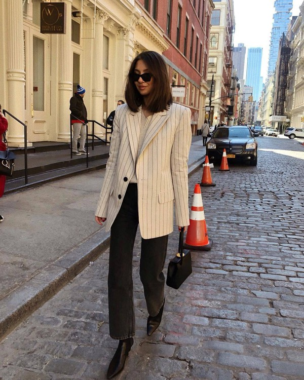 jacket white blazer stripes black boots black jeans straight jeans high waisted jeans black bag handbag white sweater