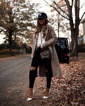jeans,black jeans,ripped jeans,pumps,long coat,hoodie,crossbody bag,cap