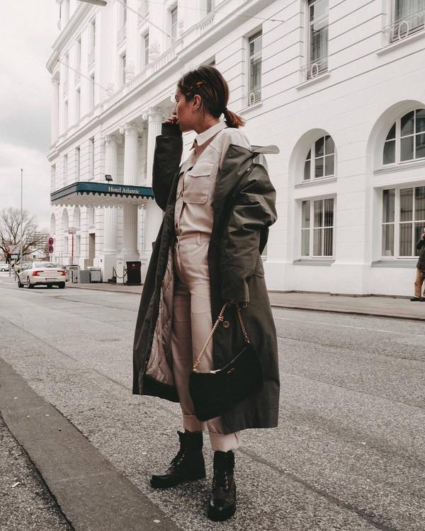 coat trench coat green coat long coat black boots combat boots pink pants pink shirt denim jacket shoulder bag