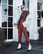 pants,high waisted pants,pleated,white boots,ankle boots,faux fur coat,white coat,stripes,turtleneck