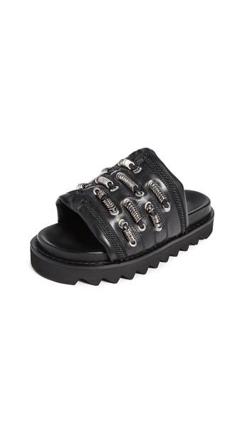 Toga Pulla Track Sole Slides in black
