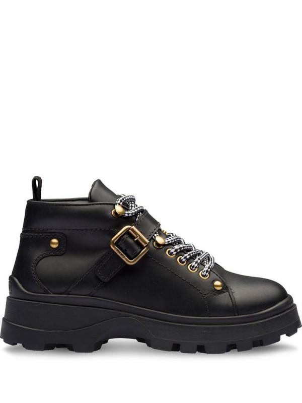 Miu Miu Leather booties in black