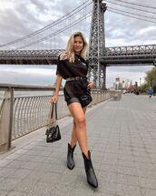 shorts,black shorts,leather shorts,black boots,cowboy boots,black t-shirt,black bag,gucci bag