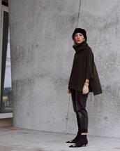 shoes,black boots,ankle boots,balenciaga,black ripped jeans,turtleneck sweater,poncho,beanie