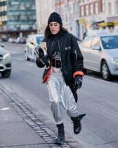 jacket,black jacket,bomber jacket,black boots,lace up boots,combat boots,silver,high waisted pants,black belt,black turtleneck top,black beanie,leather gloves