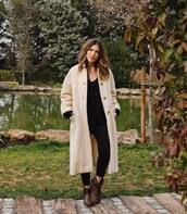 sweater,black cardigan,wool sweater,brown boots,ugg boots,black skinny jeans,teddy bear coat,long coat