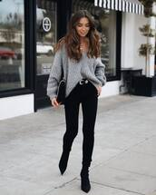 jeans,black skinny jeans,high waisted jeans,black boots,heel boots,grey sweater,oversized sweater,v neck,black belt,black bag