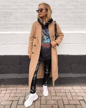 coat,long coat,double breasted,white shoes,black vinyl pants,black hoodie,sunglasses,black bag,shoulder bag
