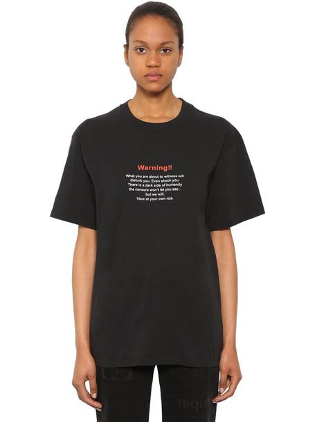 VETEMENTS Oversize Warning Cotton Jersey T-shirt in black