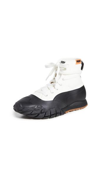 PUMA Kyron CSM Sneakers in black