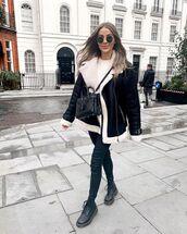 jacket,shearling jacket,black boots,black skinny jeans,white sweater