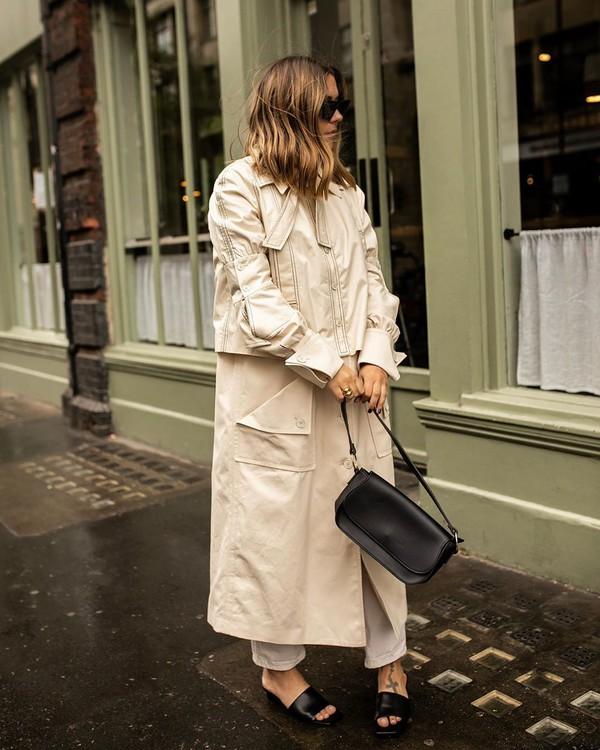 coat trench coat long coat slide shoes black bag white jeans