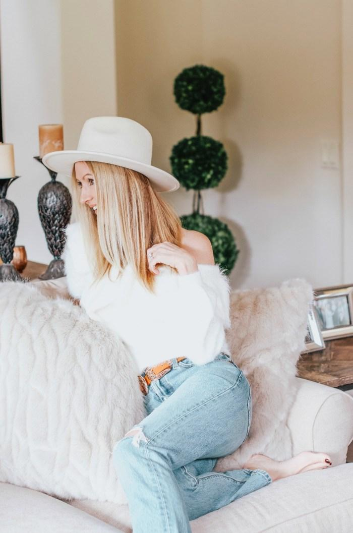the stylish housewife blogger sweater jeans bag belt hat