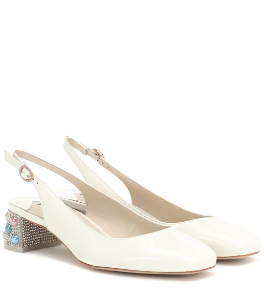 Sophia Webster Alice patent leather slingback pumps in white