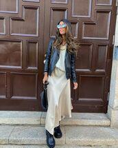 skirt,midi skirt,asymmetrical skirt,black boots,black leather jacket,white sweater,black bag