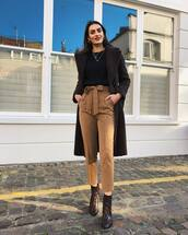 pants,high waisted pants,pleated,snake print,ankle boots,black coat,black sweater