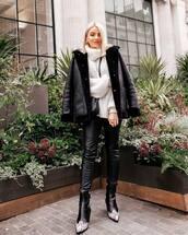 pants,leather pants,black pants,topshop,black boots,cowboy boots,black jacket,aviator jacket,turtleneck sweater,black bag