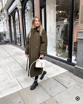coat,long coat,black boots,white bag,black jeans