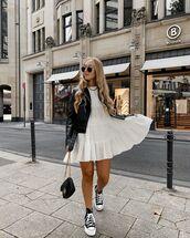 dress,white dress,babydoll dress,black leather jacket,black bag