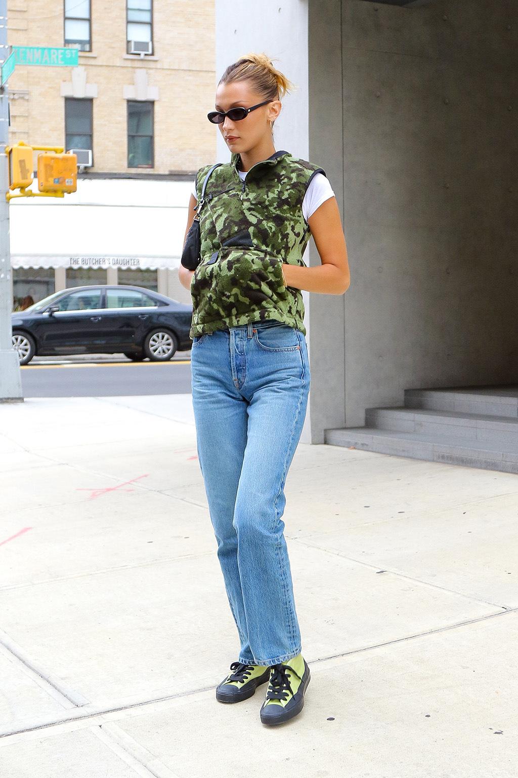 jacket camouflage camo jacket bella hadid model off-duty jeans celebrity