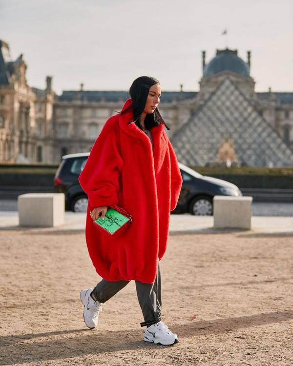 coat oversized coat red coat balenciaga white sneakers grey pants handbag