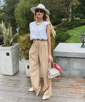 top,white t-shirt,high waisted pants,pleated,handbag,shoes,hat