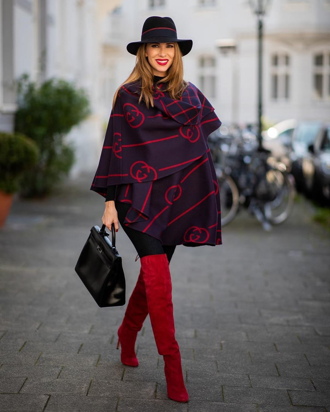 shoes over the knee boots red boots black bag black leggings hat poncho