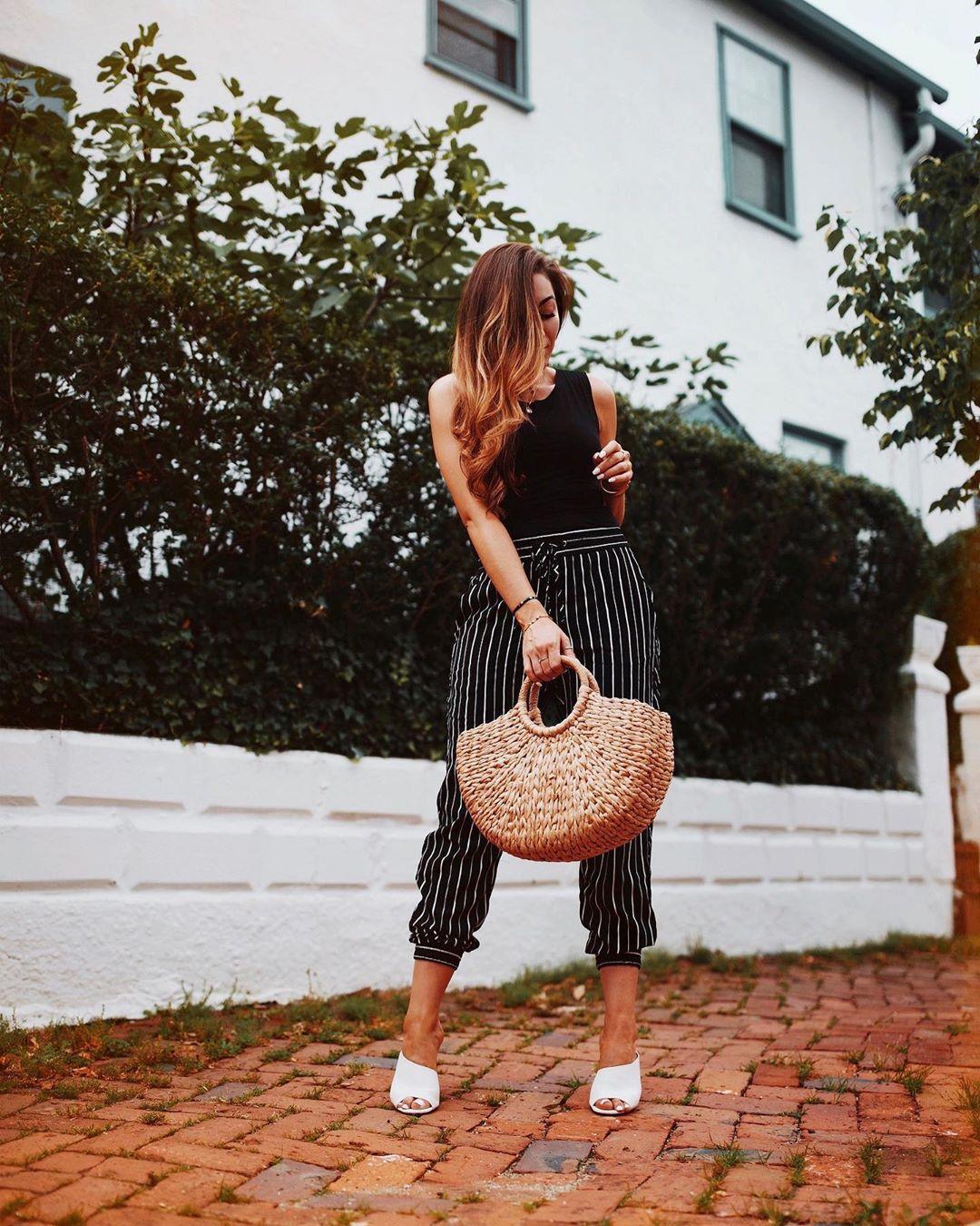 pants black pants striped pants white sandals woven bag black top