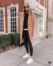 pants,black leggings,white sneakers,coat,black hoodie,black bag