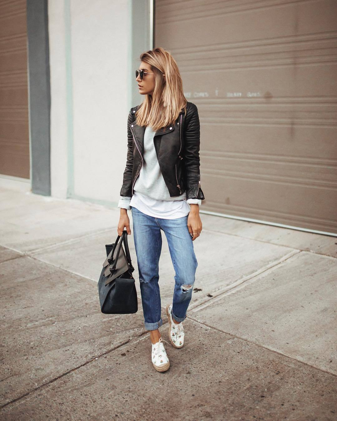 jeans ripped jeans boyfriend jeans white shoes platform shoes celine shoulder bag black leather jacket grey sweater white top