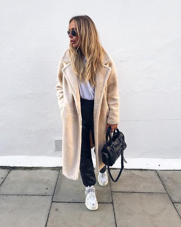 coat faux fur coat sneakers black pants white t-shirt black bag
