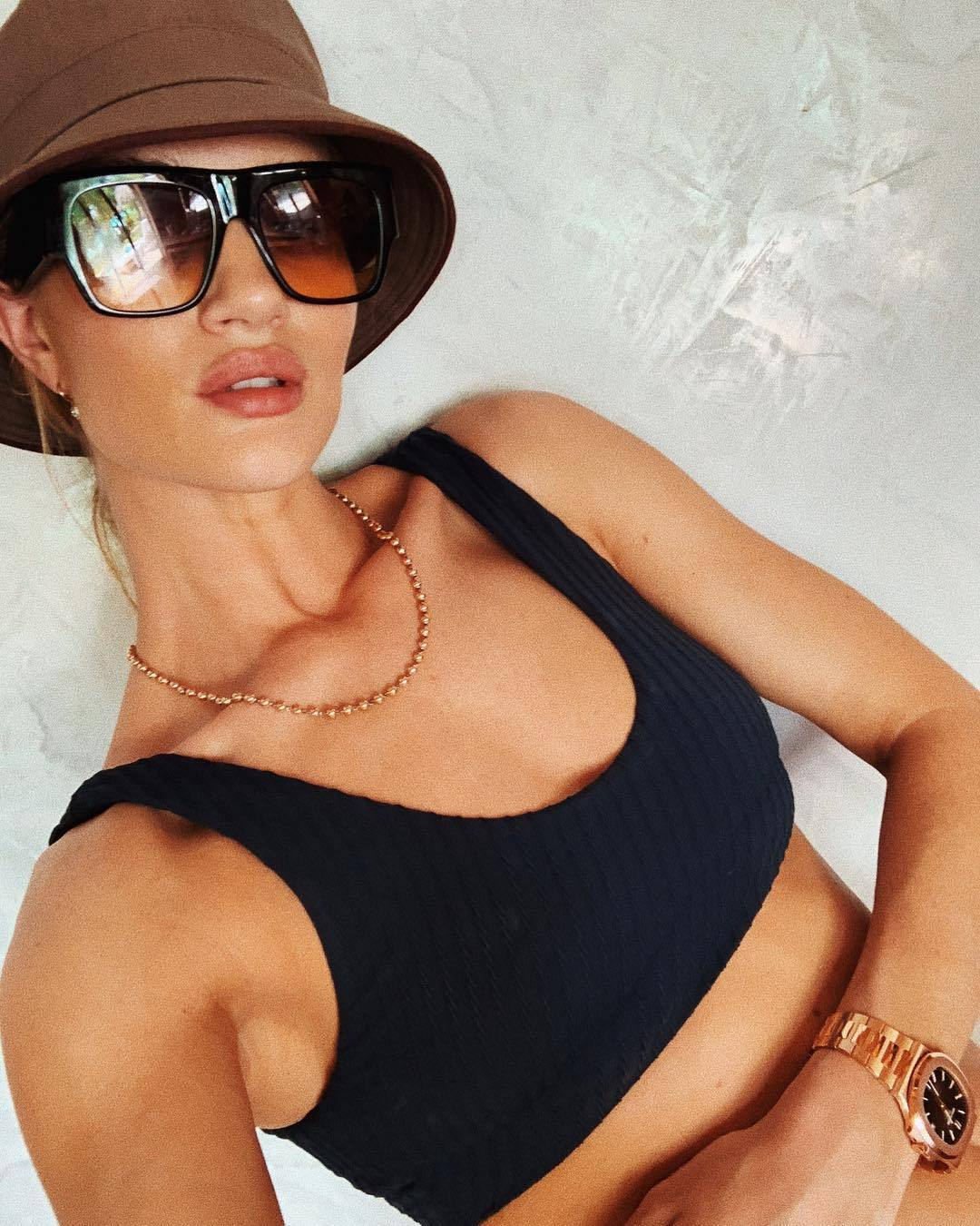 hat brown bucket hat rosie huntington-whiteley model off-duty celebrity bikini top bikini bottoms black bikini