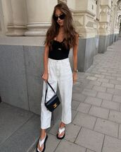 jeans,white jeans,high waisted jeans,flat sandals,black top,black bag