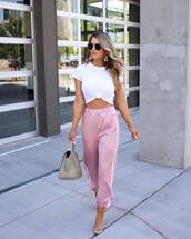 pants,pink pants,high waisted pants,joggers,sandal heels,bag,white t-shirt,crop tops