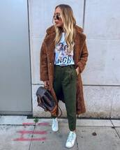 pants,green pant,zara,trainers,adidas,backpack,louis vuitton,teddy bear coat,long coat,brown coat,white t-shirt