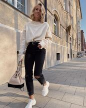 jeans,black skinny jeans,ripped jeans,white sneakers,white sweater,chanel bag