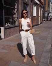 pants,white pants,high waisted pants,slide shoes,tank top,white top,black belt,bag