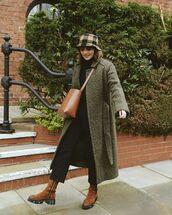coat,long coat,green coat,brown boots,black jeans,turtleneck sweater,crossbody bag,bucket bag