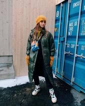 coat,puffer jacket,white sneakers,jeans,turtleneck,gloves,backpack,leather gloves,fur hat