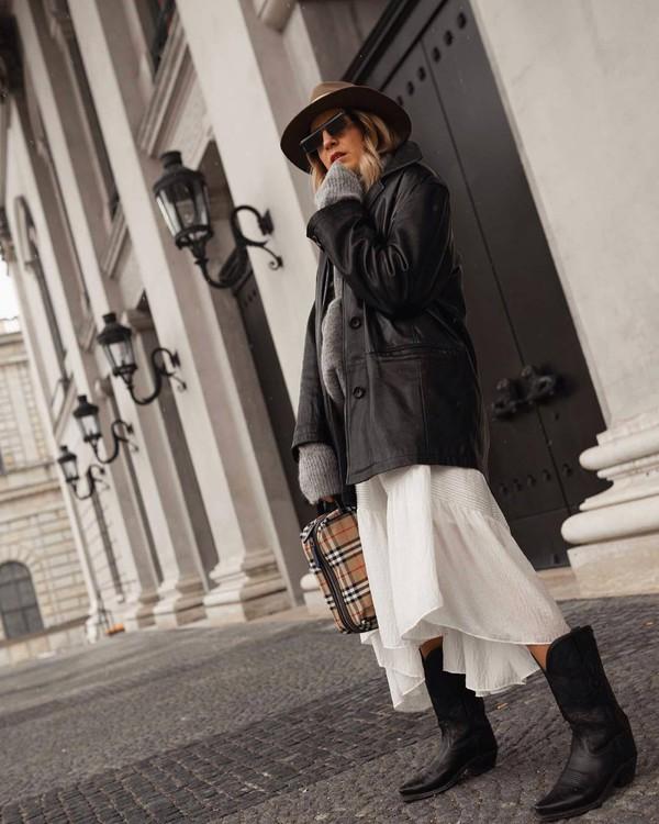 shoes cowboy boots black boots white skirt midi skirt plaid handbag black leather jacket oversized jacket grey sweater turtleneck sweater hat